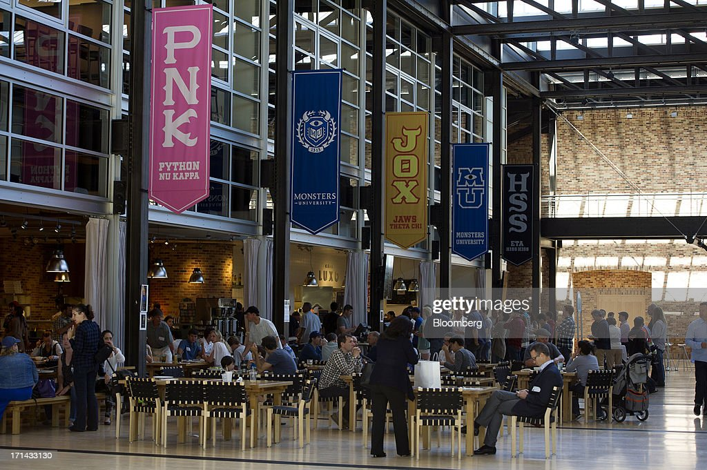 Employees and visitors sit in the lobby and food court of the Steve Jobs Building at the Pixar Animation Studios headquarters in Emeryville, California, U.S., on Friday, June 21, 2013. Walt Disney Co.s Pixar animation 'Monsters University' took first place at U.S. and Canadian theaters this past weekend with $82 million in ticket sales, overcoming Brad Pitts zombie apocalypse tale 'World War Z,' which was second with $66 million. Photographer: David Paul Morris/Bloomberg via Getty Images