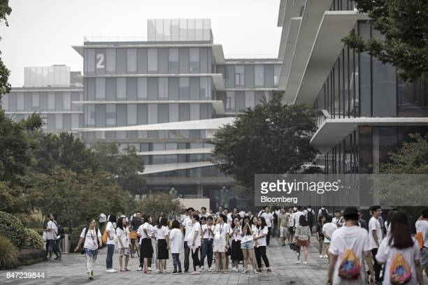 Employees and visitors walk around the Alibaba Group Holding Ltd headquarters in Hangzhou China on Friday Sept 8 2017 After conquering grocery...