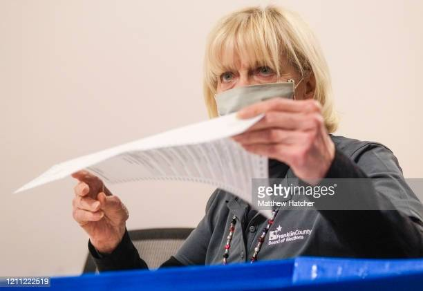 Employees and volunteers of the Franklin County Board of Elections sort through, and de-stub both mail in ballots and provisional ballots on April...