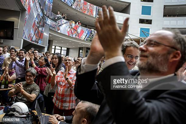 CERN employees applaud after the annoucement of the winners of the Nobel Prize for Physics on October 8 2013 in Meyrin near Geneva Peter Higgs of...