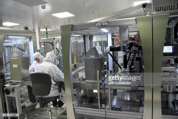 Employees are at work at Allergan's RD and global production site on September 25 2017 in Pringy Allergan is a global pharmaceutical company focused...