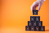 Employees are represented by wooden cubes. Business concept for human resources.
