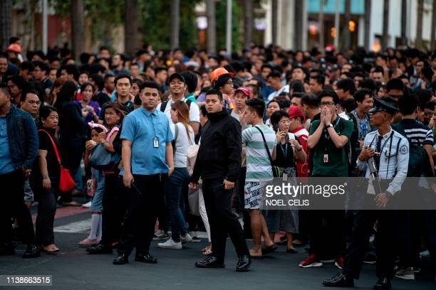 Employees are seen at an open area in Manila after an earthquake rocked the Philippines on April 22 2019 A powerful earthquake rocked the Philippines...