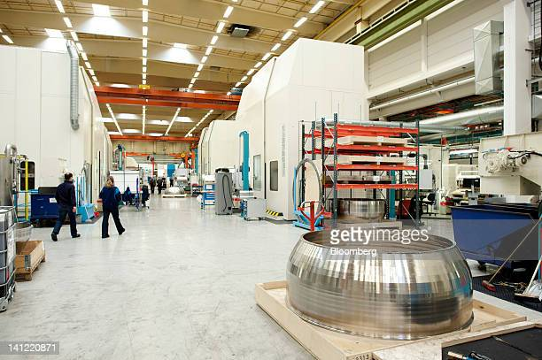 Employees are seen in one of the manufacturing areas of the Volvo Aero factory a division of Volvo AB in Trollhaettan Sweden on Monday March 12 2012...