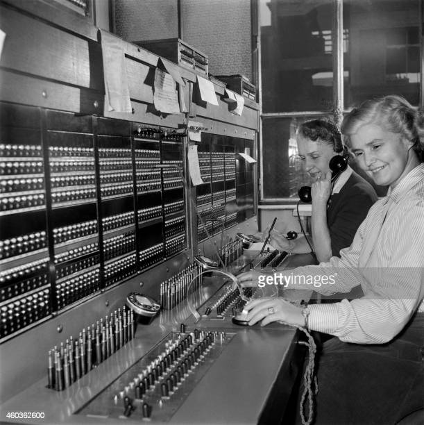 Employees are seen working in the switchboard of French press agency Agence FrancePresse in Paris in November 1955
