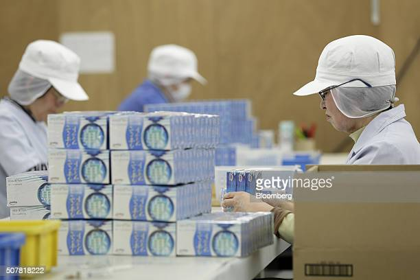 Employees arrange boxes of latex condoms for boxing at a Sagami Rubber Industries Co factory in Atsugi Kanagawa Prefecture Japan on Thursday Jan 28...