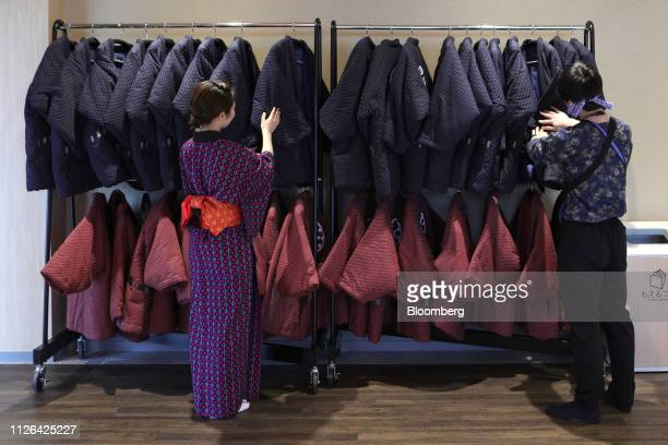 Employees arrange padded kimono jackets on a rack at the Solaniwa Onsen spa at Osaka Bay Tower during a media tour in Osaka, Japan, on Thursday, Feb....