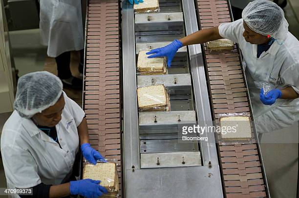 Employees arrange wrapped Passover matzo to go into cartons at the Manischewitz Co factory in Newark New Jersey US on Thursday Feb 20 2014...