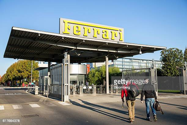 Employees arrive at the Ferrari SpA headquarters and automobile plant in Maranello Italy on Tuesday Oct 4 2016 After Britain's stunning decision to...