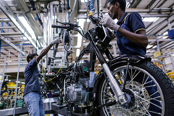 Employees assemble a Royal Enfield Motors Ltd Classic 350 motorcycle on the production line at the company`s manufacturing facility in Chennai India..