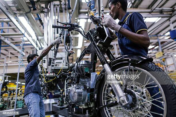 Employees assemble a Royal Enfield Motors Ltd Classic 350 motorcycle on the production line at the company's manufacturing facility in Chennai India...