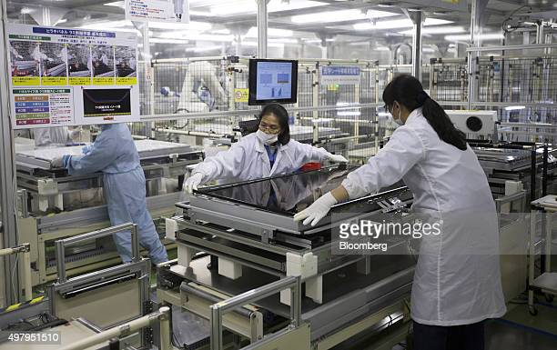 Employees assemble a Sharp Corp Aquos liquid crystal display television on the production line of the company's plant in Yaita Tochigi Prefecture...