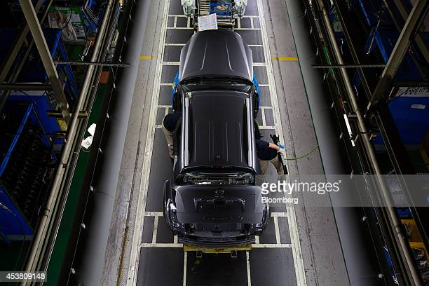 Employees assemble a Ssangyong Motor Co Korando C sportutility vehicle on the production line at the company's factory in Pyeongtaek South Korea on...