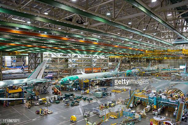 Employees assemble Boeing Co 777 airplanes on a moving production line at the company's facility in Everett Washington US on Tuesday June 25 2013...