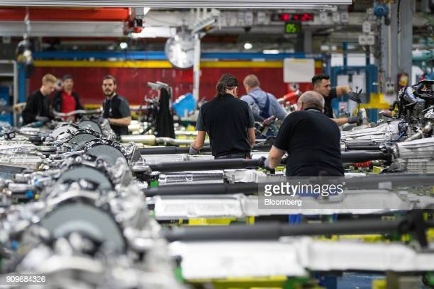 Employees assemble powertrain systems on the MercedesBenz SClass automobile production line at the automaker's factory in Sindelfingen Germany on...