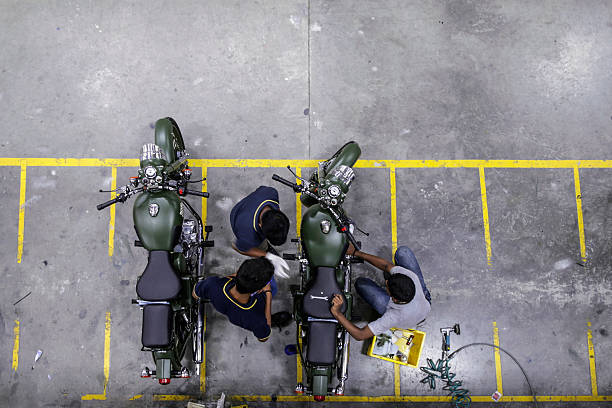 Employees assemble Royal Enfield Motors Ltd Classic 350 motorcycles at the company`s manufacturing facility in Chennai India on Tuesday July 14 2015..