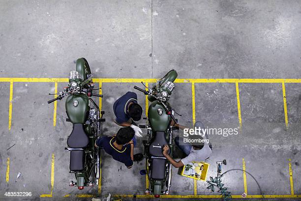 Employees assemble Royal Enfield Motors Ltd Classic 350 motorcycles at the company's manufacturing facility in Chennai India on Tuesday July 14 2015...