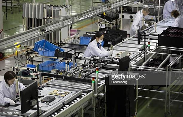 Employees assemble Sharp Corp Aquos liquid crystal display televisions on the production line of the company's plant in Yaita Tochigi Prefecture...