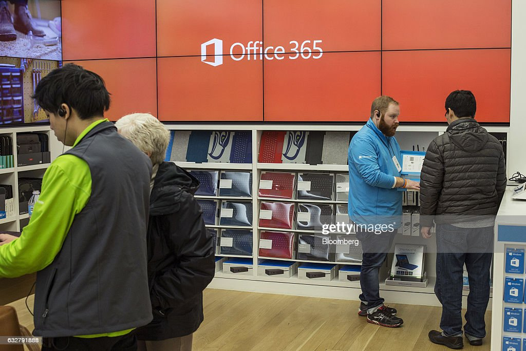 Employees assist customers at a Microsoft Corp. store in Bellevue, Washington, U.S., on Thursday, Jan. 26, 2017. Microsoft Corp.'s second-quarter sales and profit exceeded analysts' projections, bolstered by rising customer sign-ups for Azure and Office cloud-computing services. Photographer: David Ryder/Bloomberg via Getty Images