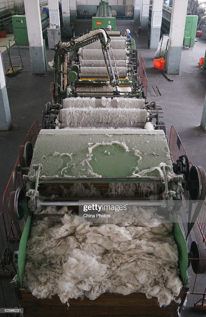 Employees at a Qinghai Tibetan Sheep Carpets (Group) Ltd. factory work with a machine to produce carpet April 4, 2005 in Xining, Qinghai Province, northwest China. Qinghai Tibetan Sheep Carpets is a famous import and export enterprise in China's west region, with its traditional Tibetan carpets exported to more than 24 countries and regions in Europe, Asia and the U.S. The Chinese government is seeking ways to boost development of the west region, as economic growth of eight percent has been forcast for this year.
