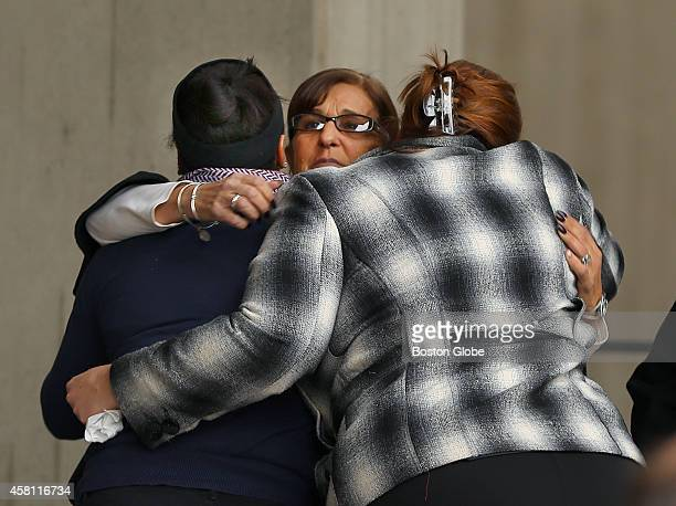 Employees at Boston City Hall embrace as they wait for Mayor Marty Walsh to speak to the media about the passing of former Boston mayor Thomas M...
