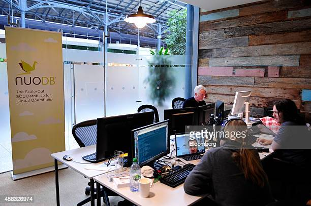 Employees at database startup company Nuo DB use computers in Dogpatch Labs inside the CHQ shopping mall in Dublin Ireland on Thursday Sept 3 2015...