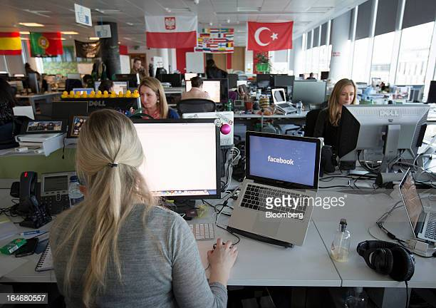 Employees at Facebook are seen working inside the office of Facebook Inc's European headquarters at Hanover Quay in Dublin Ireland on Thursday March...