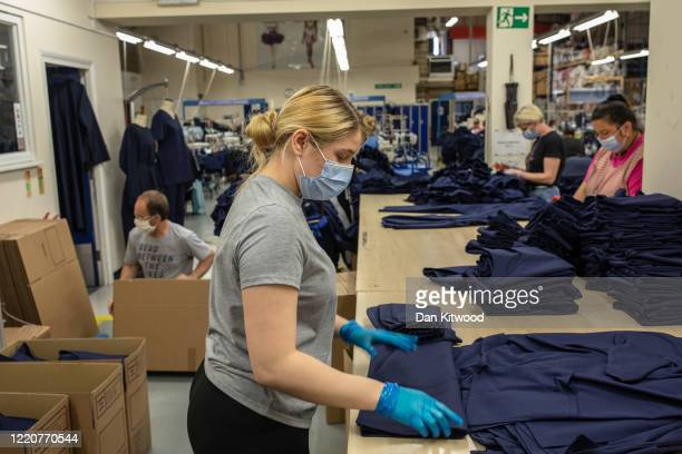 Employees at 'Fashion Enter' make scrubs for NHS staff on April 24, 2020 in London, England.The British government has extended the lockdown...