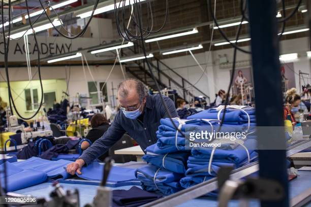 Employees at 'Fashion Enter' make scrubs for NHS staff on April 24 2020 in London EnglandThe British government has extended the lockdown...
