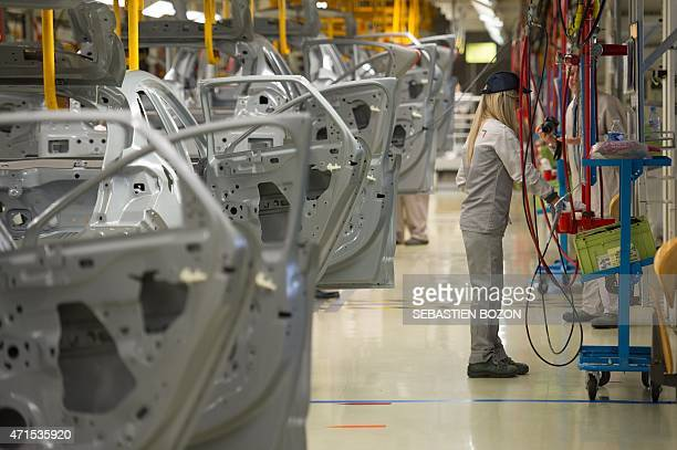 Employees at French auto maker PSA Peugeot Citroen factory in Mulhouse works on April 29 2015 at the painting workshop of the plant in Mulhouse AFP...