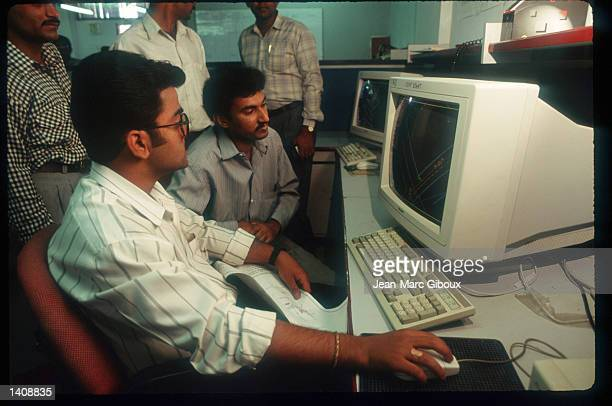 Employees at Infosys use computers in their office March 12 1996 in Bangalore India Bangalore housing over 6 million people with a thriving business...