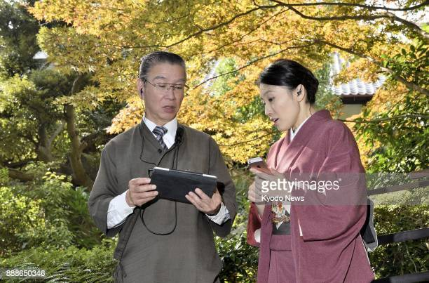 Employees at Jinya a Japanesestyle inn in Hadano Kanagawa Prefecture near Tokyo use a tablet to manage their inn on Nov 10 2017 ==Kyodo