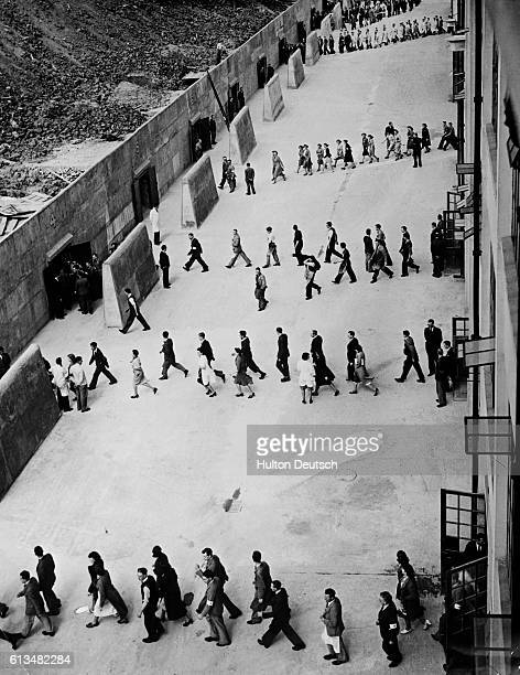 Employees at Standard Telephones and Cables Ltd participating in air raid drill in New Southgate, London, 1939.
