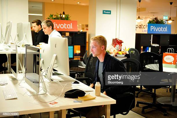 Employees at tech start-up company Pivotal use computers in Dogpatch Labs inside the CHQ shopping mall in Dublin, Ireland, on Thursday, Sept. 3,...