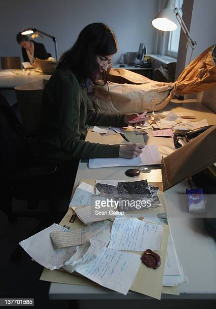 Employees at the federal archives of the former East German secret police the Stasi analyse torn remains of documents to determine their priority for...