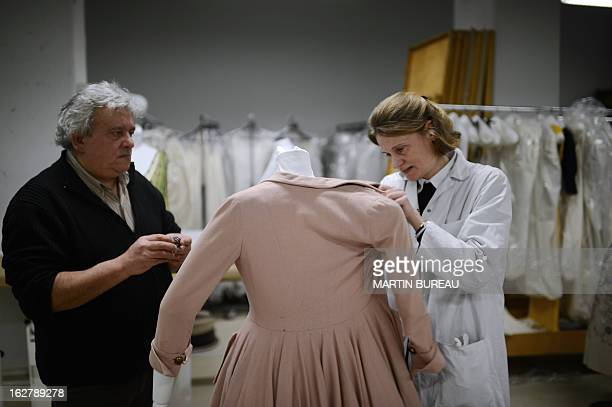 Employees at the Galliera museum work on dresses for the exhibition 'Paris Haute Couture' which will take place at the Hotel de Ville on January 28...