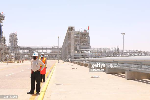 Employees at the Hawiyah Natural Gas Liquids Recovery Plant, operated by Saudi Aramco, in Hawiyah, Saudi Arabia, on Monday, June 28, 2021. The...