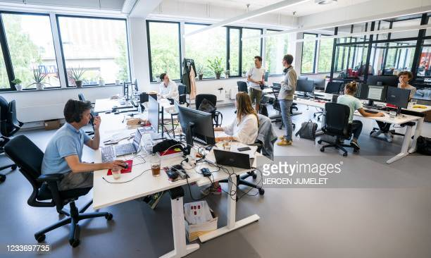 Employees at the online supermarket Picnic are seen at their desks in their office in Duivendrecht, northern Netherlands on June 28 after advice to...