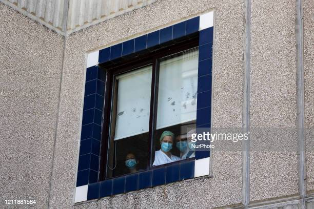 Employees at window of hospital in an attempt to see the health ministerMinister of Health Marta Temido opens a new intensive care unit at Hospital...