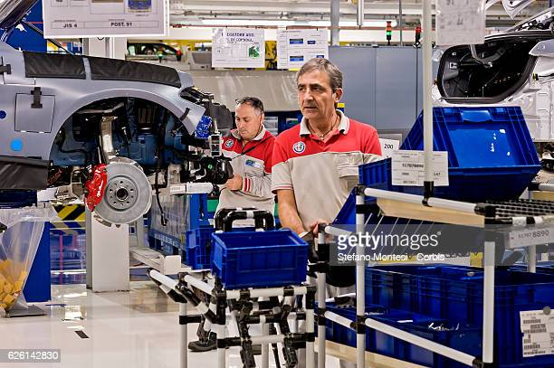 Employees at work in the Assembly Lines where they assemble the Alfa Romeo Giulia in the Cassino Assembly Plant FCA Group on November 24 2016 in...