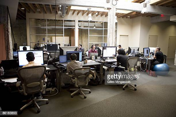 Employees at work in the Facebook headquarters, where the atmosphere is casual and laid-back, in Palo Alto, March 31, 2009. Founded in 2004, Facebook...