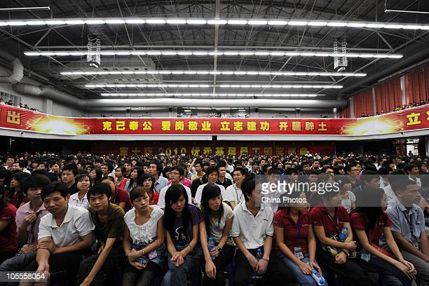 Employees attend the award ceremony for grass roots employees of the year at Foxconn's industrial complex in Longhua township on October 16 2010 in...