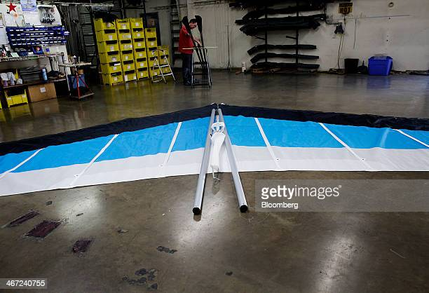 Employees begin assembly on a hang glider at the Wills Wing manufacturing facility in Orange California US on Tuesday Feb 4 2014 Wills Wing the...