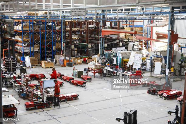 Employees build and test mobile robots also known as an AGV or automated guided vehicle inside the Automatismos y Sistemas de Transporte Interno SAU...