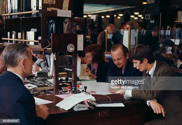 Employees busy working inside Lloyd's of London London circa 1960