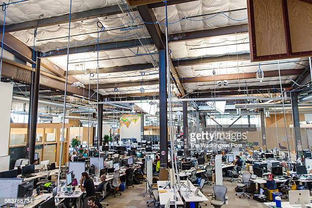 Employees can be seen inside Facebook's which may be the longest continuous work space in the world.