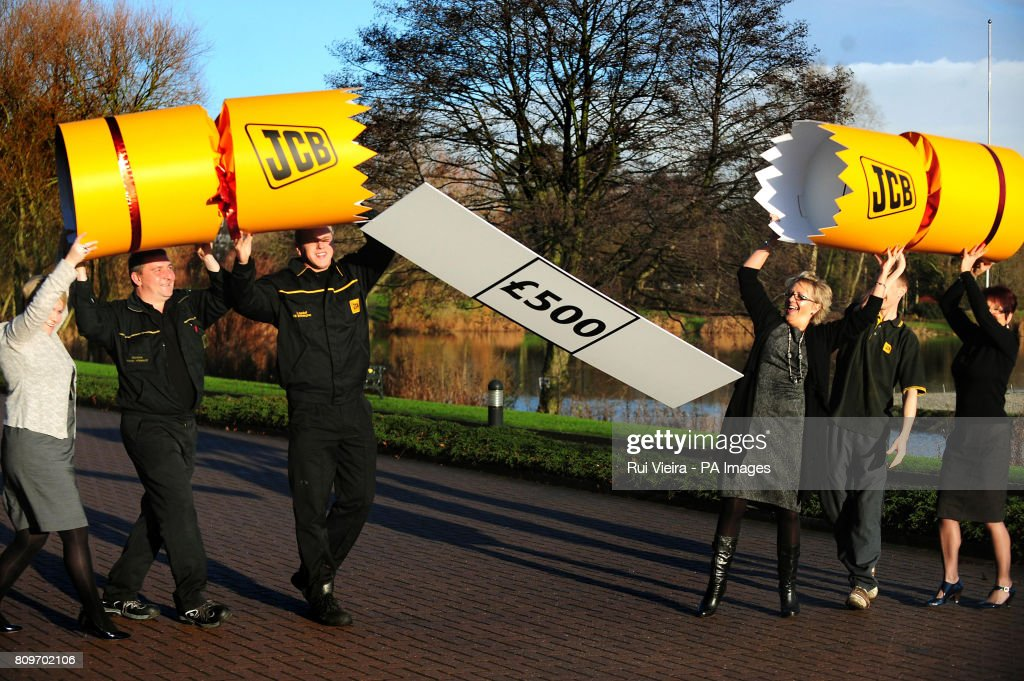 JCB employees celebrate after the company announced a £