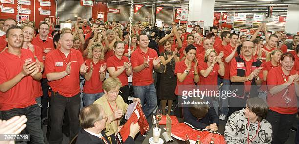 Employees celebrate before the opening of the latest branch of the electronic shopping center Mediamarkt at the shopping mall Alexa September 11 2007...