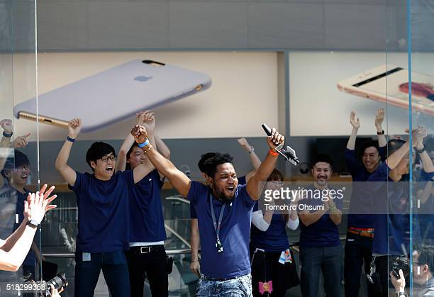 Employees cheer before the launch of Apple Inc iPhone SE and iPad Pro 97 inch at the company's Omotesando store on March 31 2016 in Tokyo Japan Apple...