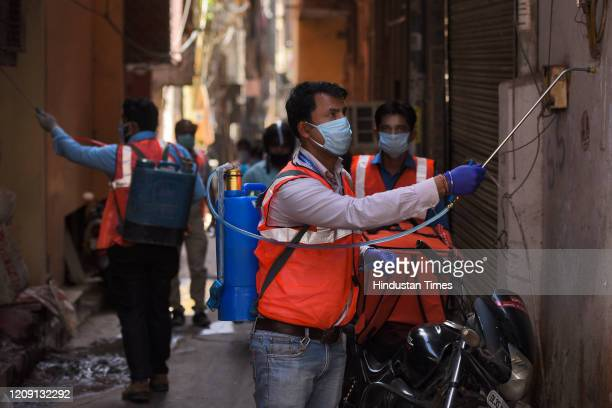 SDMC employees chemically disinfect a locality on day eleven of the 21day nationwide lockdown to curb the spread of coronavirus at Krishna Market...